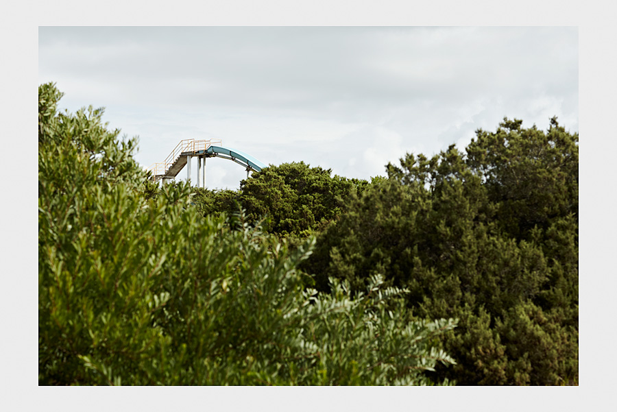 Jon Day Photography. Water slide and bushes.